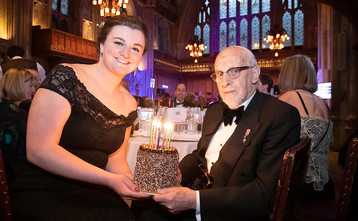 Lucinda Baker presents a cake to fellow Liveryman, Walter Balmford MBE, who was celebrating his 90th birthday.